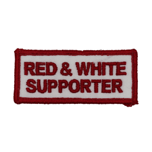 red and white supporter patch, red text, white background
